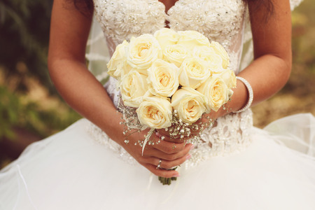 wedding decoration: Beautiful bride holding a gorgeous bouquet on wedding day