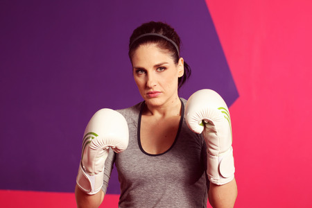 latinamerican: Portrait of a female boxer with gloves Stock Photo