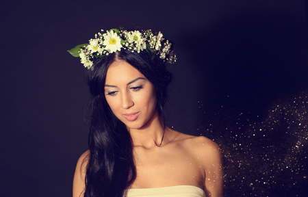 tender sentiment: Gorgeous young women with beautiful chaplet flowers on isolated background