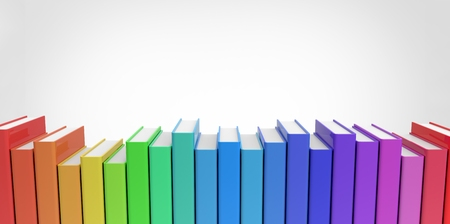 Row stack of colorful books on a plain background