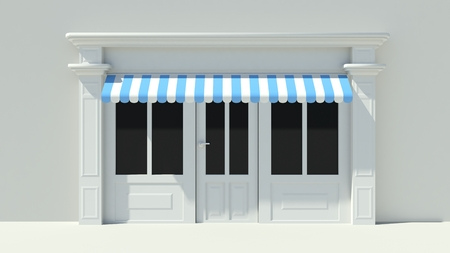 Sunny Shopfront with large windows White store facade with blue and white awnings