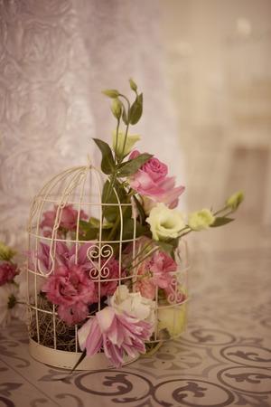 birdcage: Beautiful flowers in birdcage
