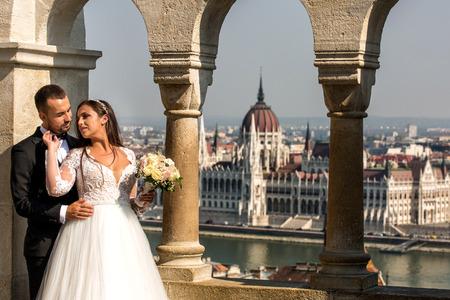Beautiful wedding couple posing in castle