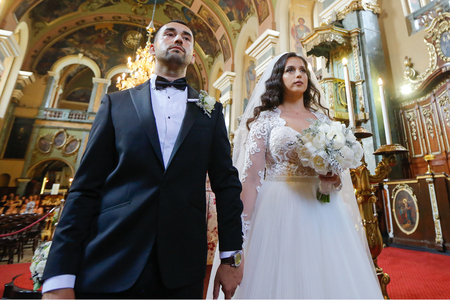 Young wedding couple in church at their wedding ceremony