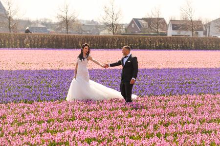 wedding couple posing in hyacinth field