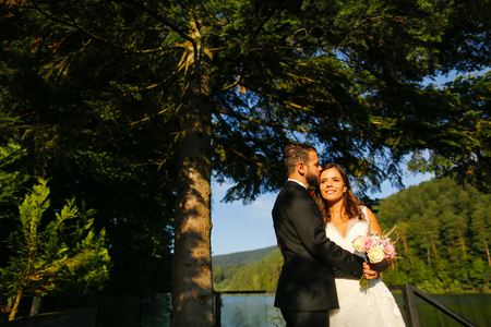 Beautiful bride and handsome groom  posing outdoor
