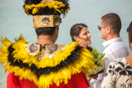 Traditional Polynesian wedding in Bora Bora. Gorgeous bride and handsome groom.