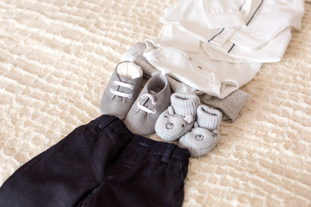 Set of baby boy clothes and black pants