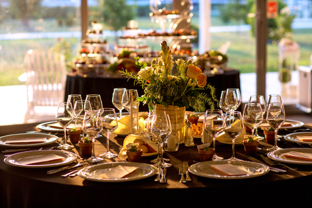 Wedding decorations. Decoration of the hall, restaurant. Black tablecloth on Round table.