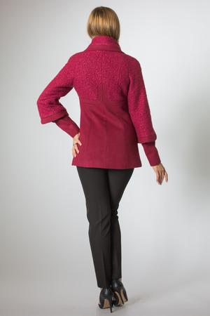 Blonde model posing in red coat and black pant