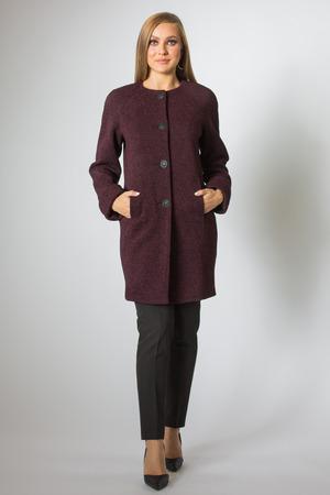 Blonde model posing in coat and black pant Фото со стока