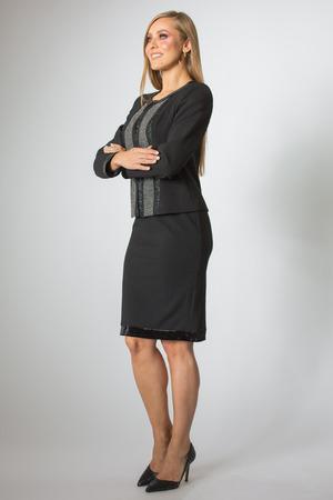 Beautiful woman posing in business suit