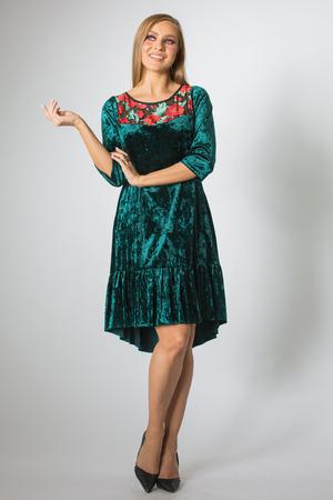 Beautiful caucasian girl posing in green dress