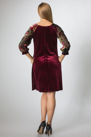 Blonde model posing in cherry-colour dress Фото со стока