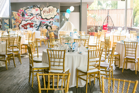 Outdoor wedding celebration in a restaurant. Festive table setting