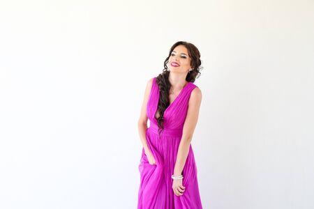 Beautiful woman posing in purple dress