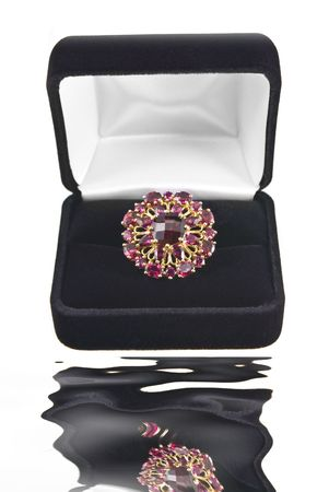 Garnet ring in black box with reflection