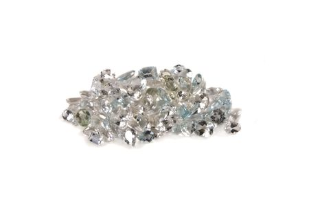 trillion: a group of mixed faceted white stones on a white background