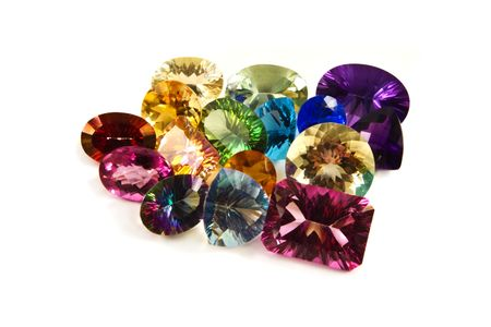 A grouping of large carat-weight gemstones on a white background Banque d'images