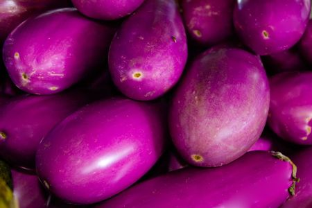 A group of eggplant at an outdoor market