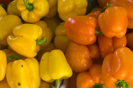 A selection of orange and yellow bell peppers
