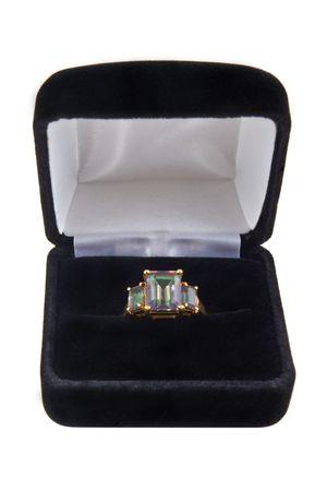 topaz: A mystic green topaz ring in a box Stock Photo