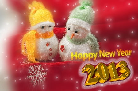 Happy New Year 2013 Greeting Card with two cute little snowmen on a red background with 3D text Stock Photo - 15797132