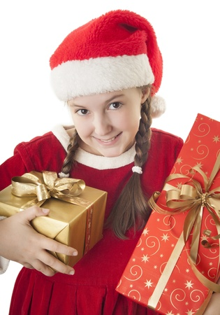 hat new year s eve: Beautiful girl dressed in Christmas clothes and red santa hat with presents in her hands isolated on white background Stock Photo