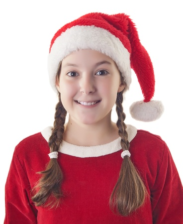 hat new year s eve: Beautiful girl dressed in Christmas clothes and red santa hat isolated on white background Stock Photo