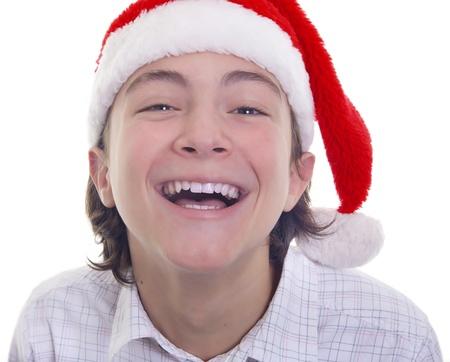 big smile: Handsome teenage boy with big smile wearing Christmas hat