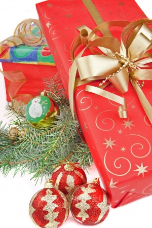 Christmas presents with gold ribbon,  Ornaments and Christmas Branch photo