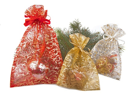 Three Chrismas presents with Christmas branch behind Stock Photo - 16241220