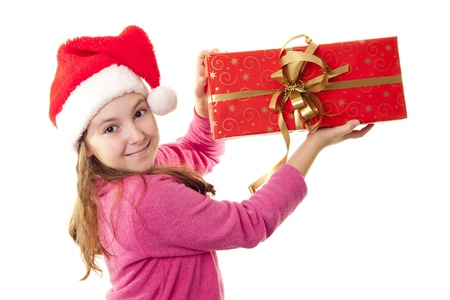 Cute little girl with Santa s hat and red present in her hands photo