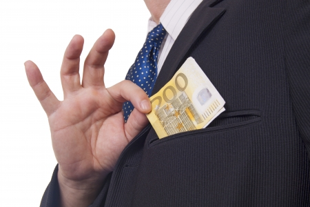 corruptible: Man putting money in his pocket  isolated