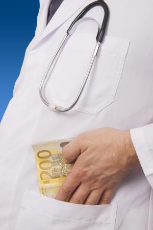 doctor putting money: Doctor Putting Money in his pocket  Bribing  200 Euro Banknote Stock Photo