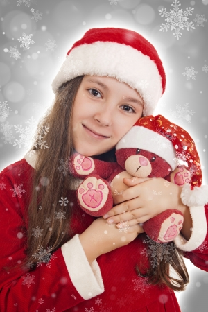 Beautiful Christmas Girl with teddy bear photo