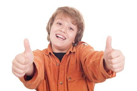 Happy boy with thumbs up, isolated on white photo