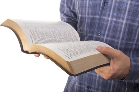 Man reading bible Standard-Bild