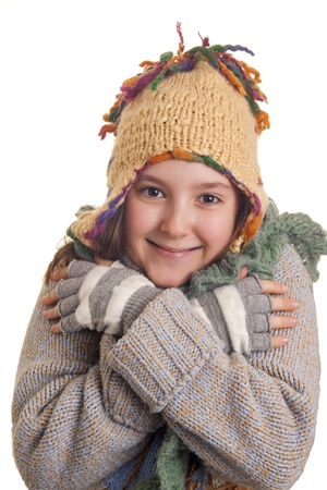 Beautiful young girl in warm winter clothes isolated on white photo