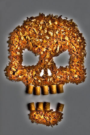 Death sign skull made of Tobacco on gray background  Smoking metaphor Stock Photo - 17821018