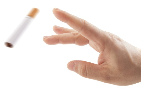 Hand trowing cigarette isolated on white Quit smoking metaphor photo