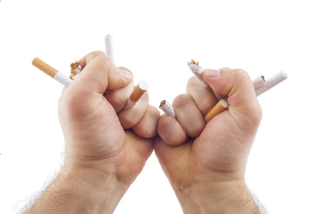 Human hands breaking cigarettes Anti smoking concept photo