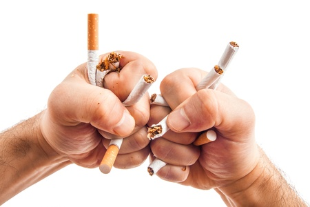 Human hands heatedly breaking cigarettes Anti smoking concept photo