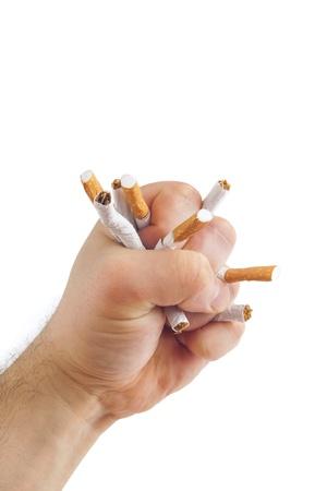 Human fist breaking cigarettes Anti smoking concept photo