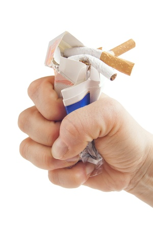 quit smoking: Human fist breaking pack of cigarettes Anti smoking concept