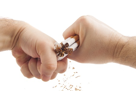 Human hands violently breaking cigarettes Anti smoking concept