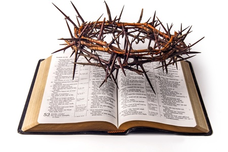 Holy bible and crown of thorns isolated on white