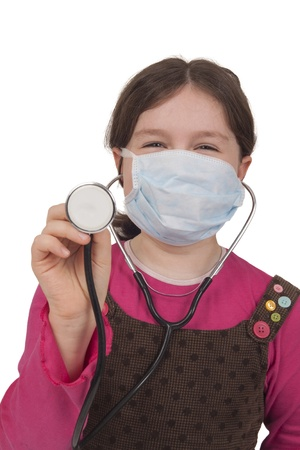 Little girl with stethoscope and surgical mask Isolated on white  Stock Photo
