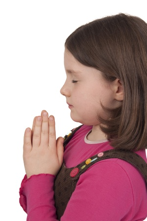 Profile of beautiful girl praying with closed eyes isolated on white background