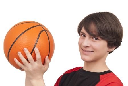 Basketball player throwing a basketball on white background photo